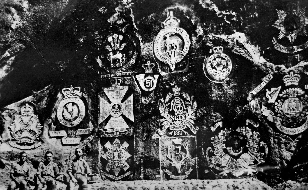 Regimental crests carved into the rocks in the Cherat Hills.jpg
